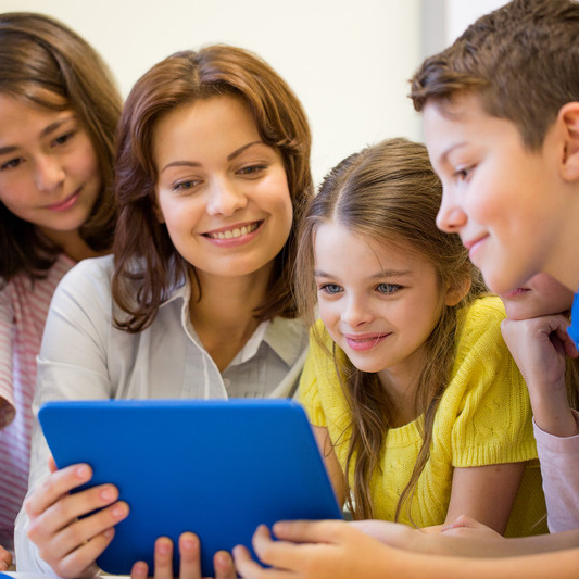 Teacher with iPad surrounded by three students