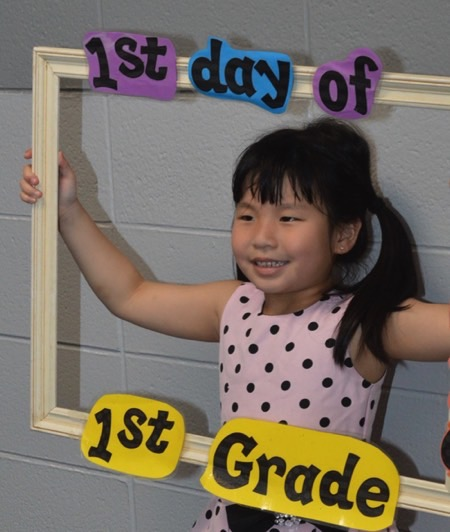 First grader getting picture made on first day