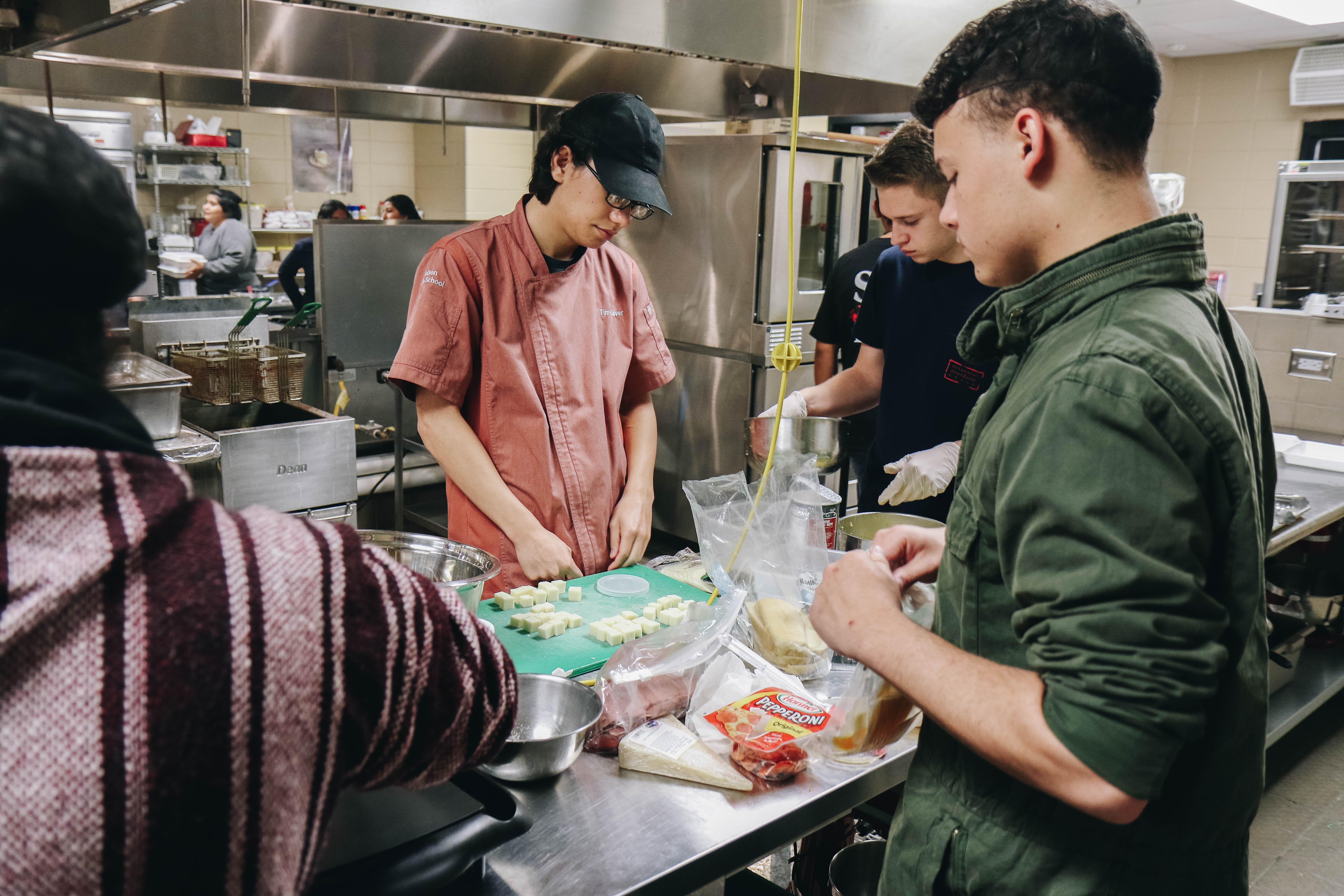 Several students working in kitchen