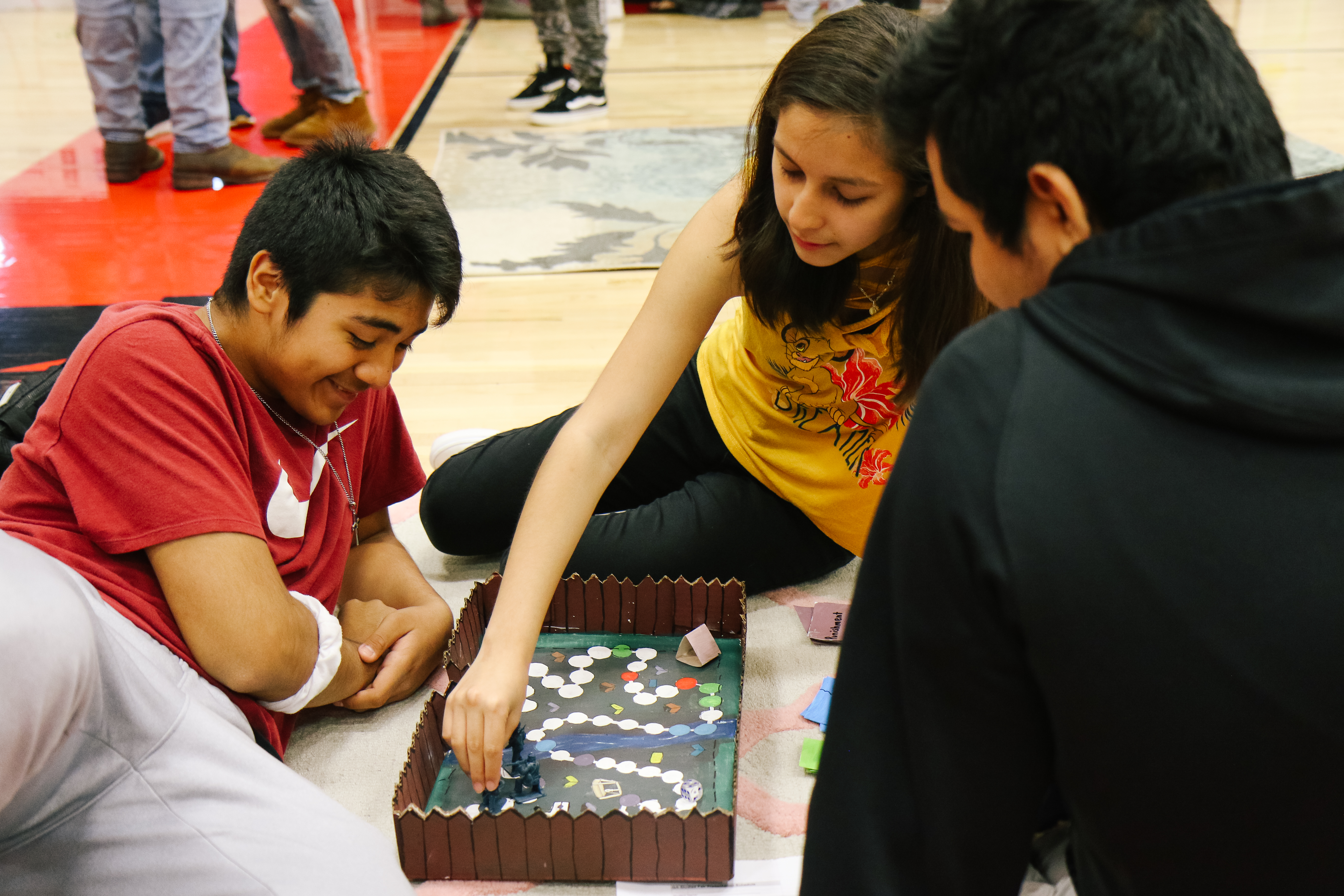 students play board game